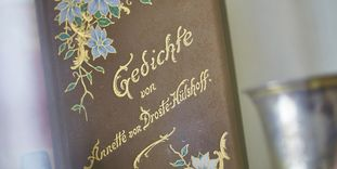 Image: Ornate volume of poetry by Annette von Droste-Hülshoff in the Meersburg Prince's Little House